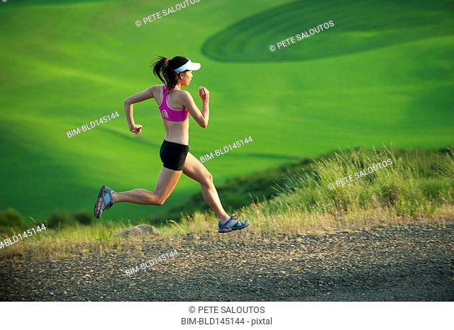 Japanese runner running in countryside