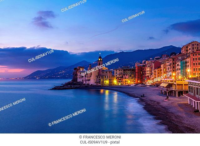 View of beach and hotels at dusk, Camogli, Liguria, Italy