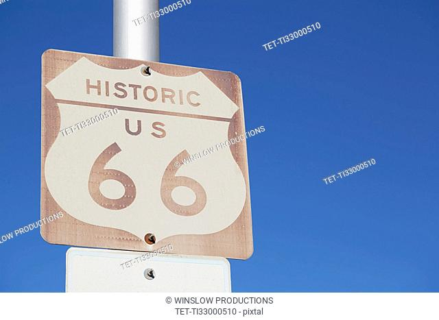 USA, Arizona, Winslow, Route 66 sign against blue sky