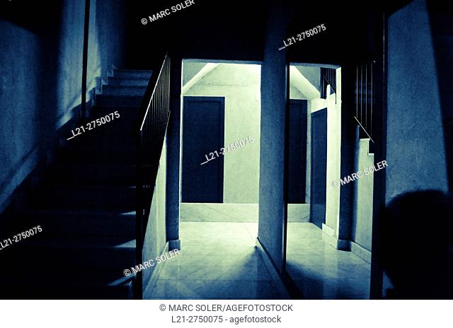 Corridor and stairs in entrance of a house at night. Barcelona, Catalonia, Spain