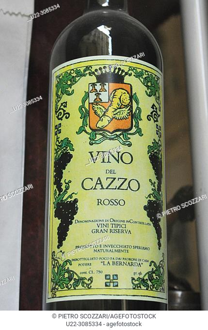 Turin, Italy: 'Vino del Cazzo' ('Fucked Wine') bottle from the window of an antique shop specialized in old erotic goods