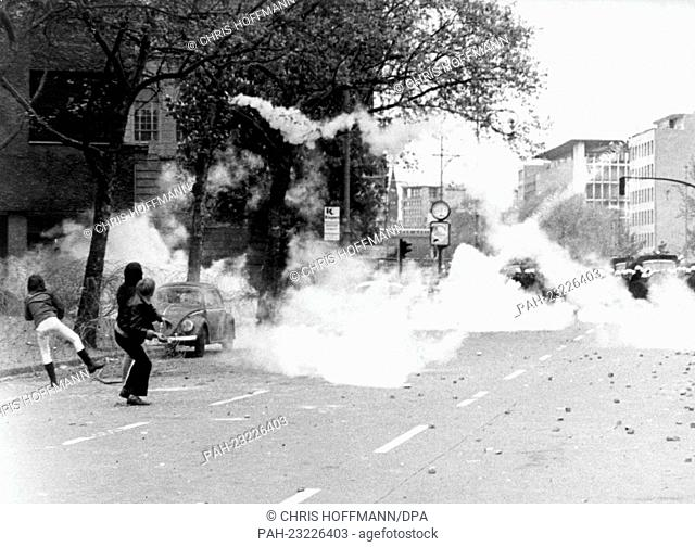 Demonstrators throwing stones on police officers on Hardenbergstraße near Ernst-Reuter-Platz in Berlin on 23rd May 1970. After the military parade on the 'Armed...