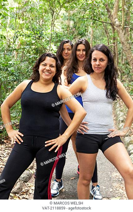 Four women in fitness outfits posing on a path, gold coast queensland australia