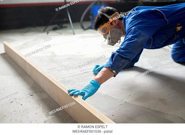 Worker checking the level of the concrete floor