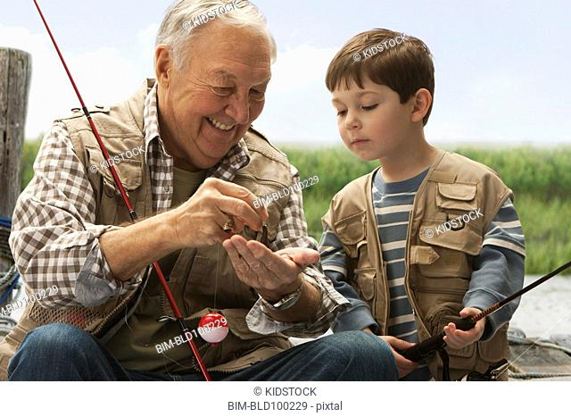 Caucasian grandfather and grandson fishing together