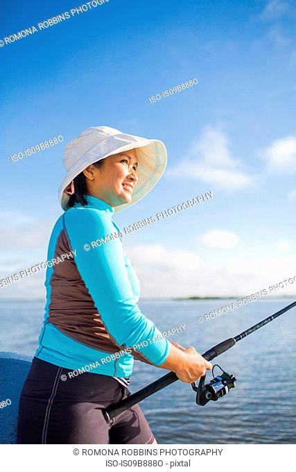 Woman fishing in the Gulf of Mexico, Homosassa, Florida, US