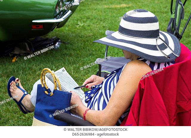 USA, Massachusetts, Beverly Farms, antique cars show, woman in hat, NR
