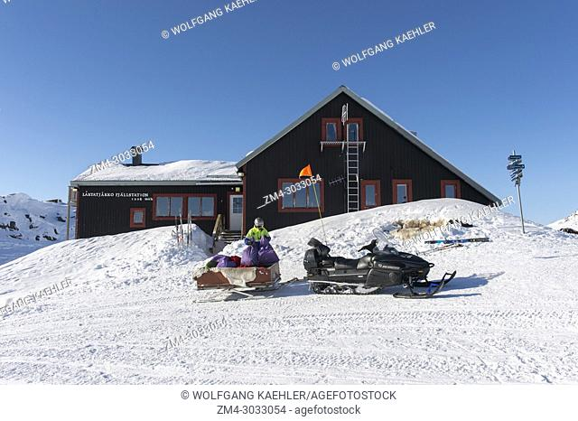 A snowmobile at the Laktatjakko Mountain Station above the Bjorkliden ski resort in Swedish Lapland, northern Sweden is with 1228 meters the highest station in...