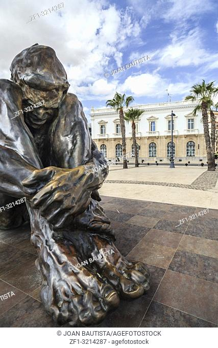 Urban art,sculpture in bronze, El Zulo by Victor Ochoa in port of Cartagena,Spain