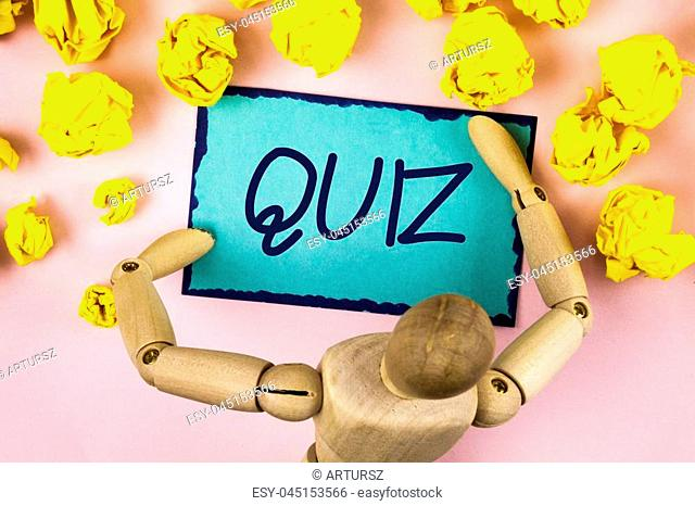 Handwriting text writing Quiz. Concept meaning Short Tests Evaluation Examination to quantify your knowledge written Sticky note paper within Paper Balls plain...