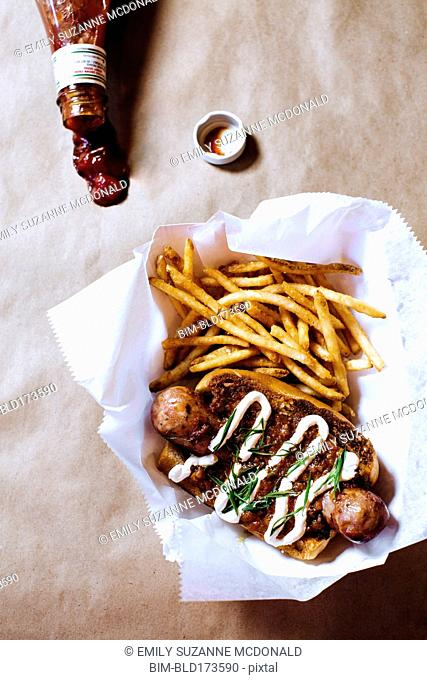 High angle view of chili dog with french fries