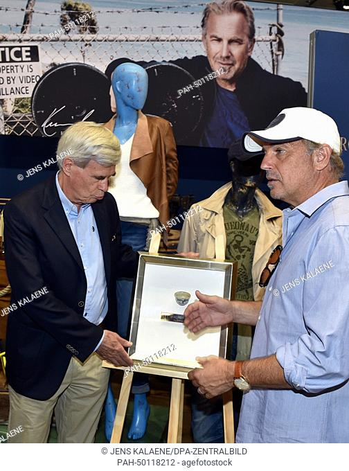 Michael Otto (L), supervisory board chairman of Otto Group, and director, actor and environmental activist Kevin Costner at the booth of the Arqueonautas label...