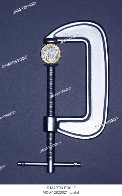 Clamp holding coin