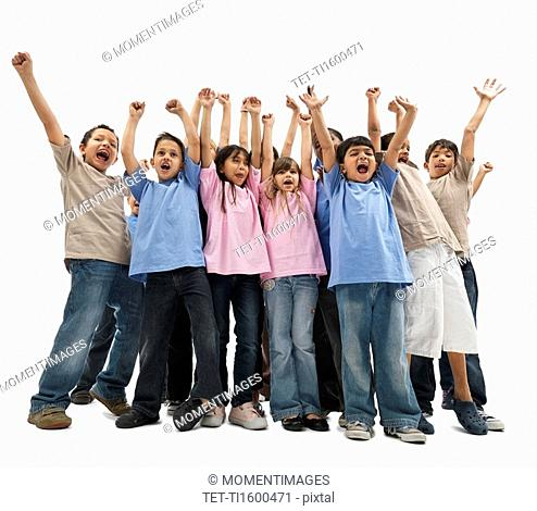 Children raising their arms