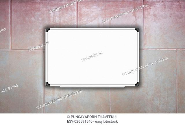 Blank white baord on ceramic tiles wall texture background, stock photo