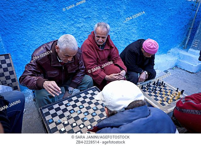 Men playing checkers and chess inside the Kasbah of the Udayas, Rabat, Morocco, North Africa
