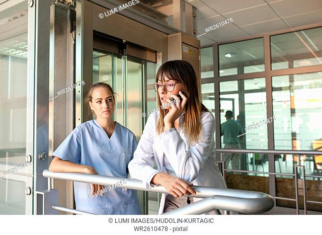 Female doctor using smartphone in medical clinic