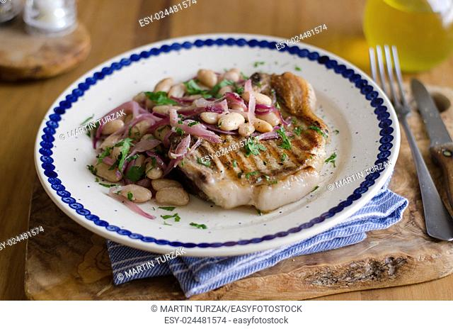 Pork with agrodolce sauce and white beans