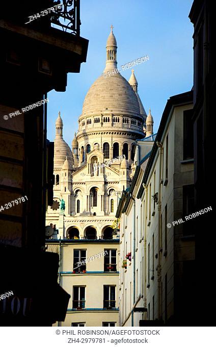 Paris, France. Montmartre. Basilique du Sacre-Coeur seen from Rue Briquet
