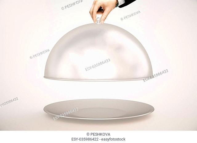 Man's hand opening silver cloche on light background. Mock up, 3D Rendering