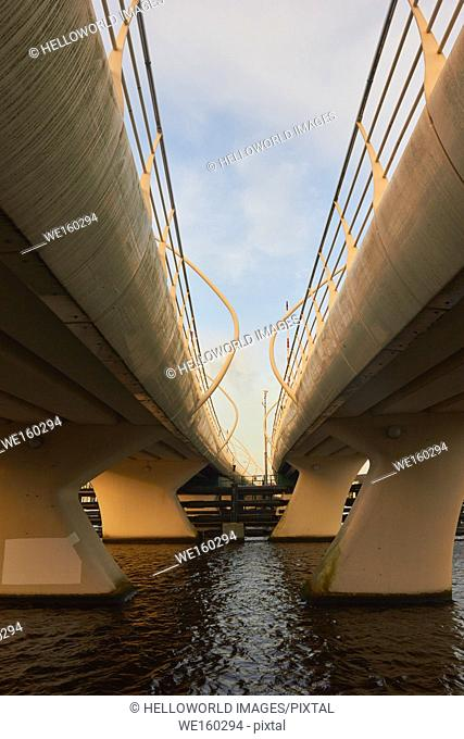 Curved lanes of flyover bridge from below, Holland