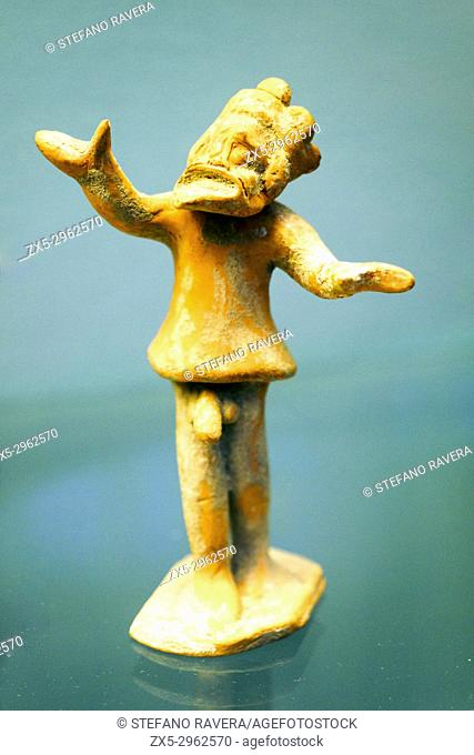Comic actor declaiming figurine made in Corinth about 400-375 BC. Hand modelled body and moulded head. terracotta