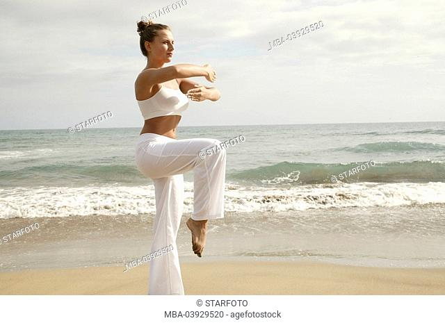 Woman, Tai Chi practice, clothing white, broached, outside, sandy beach