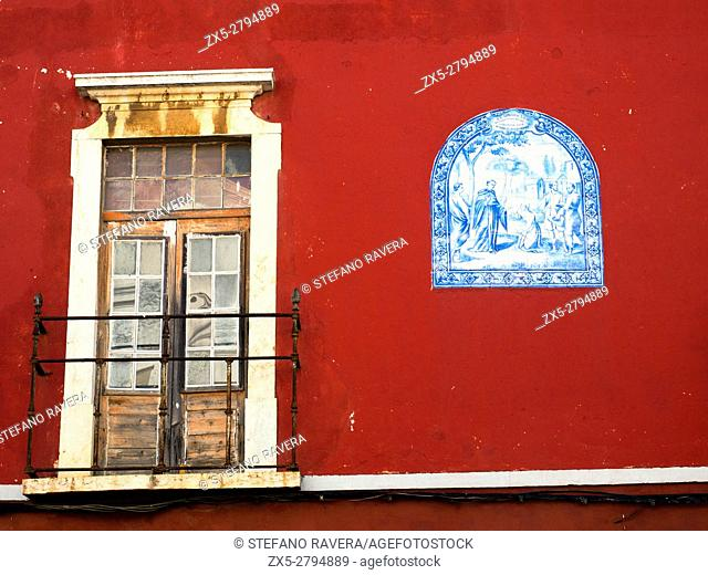 Red house facade in Faro - Algarve region, Portugal