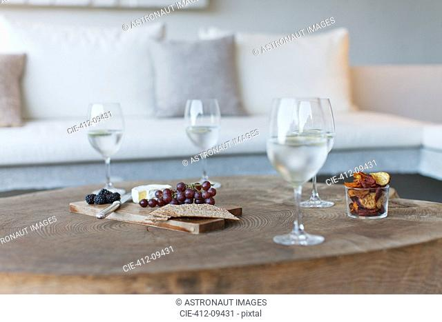 Wine and cheese on wooden coffee table