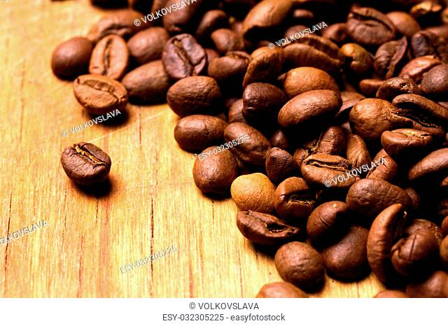Coffee beans on wood background. Coffee on grunge wooden background