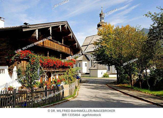 Farm house in front of the parish church Saint Michael, Sachrang, Sachrang valley, Chiemgau, Upper Bavaria, Germany, Europe