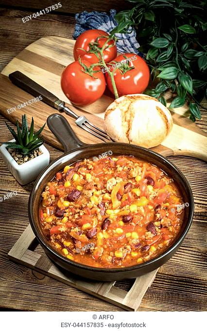Chili con carne in a clay pan. Traditional mexican cuisine