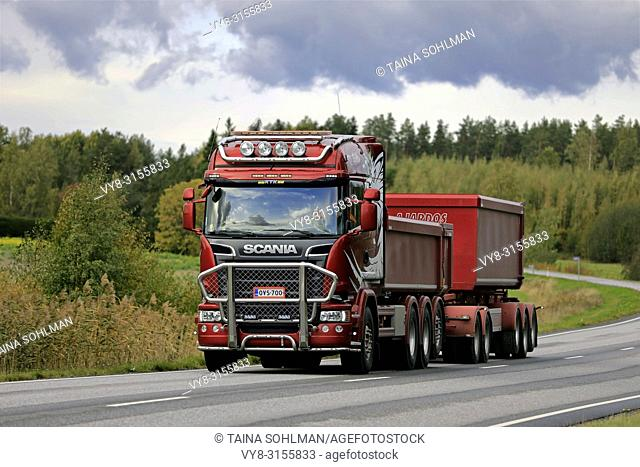 Salo, Finland - September 28, 2018: Red Scania R730 truck and gravel trailer for limestone haul of R Aalto on the road in autumn in South of Finland