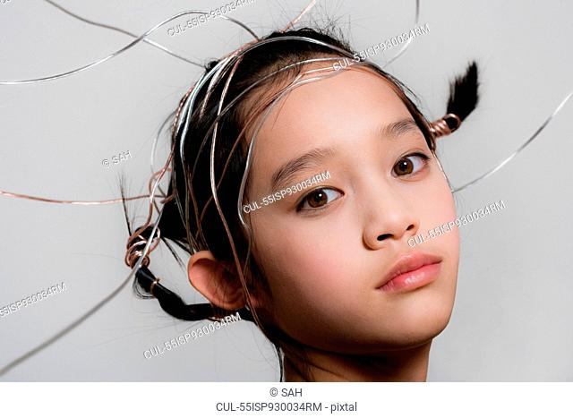 Teenage girl with ribbons in hair