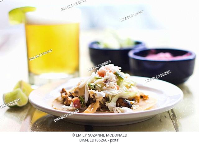 Plate of tacos with beer