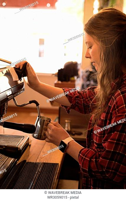 Beautiful woman preparing coffee at counter