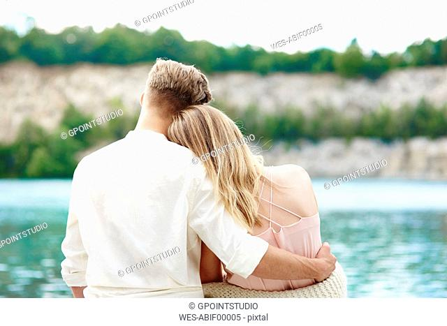 Affectionate young couple at lakeshore