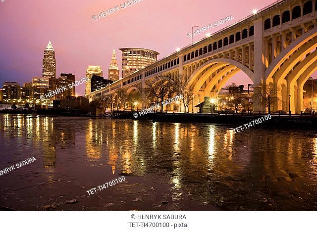 USA, Ohio, Bridge crossing Cuyahoga River at dusk Cleveland