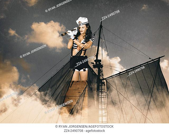 Fine art portrait of a sailor pinup girl on lookout duties from the mast of a ships crows nest. Navy scout