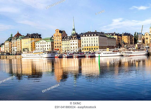Stockholm daylight skyline panorama of Gamla Stan with white ships