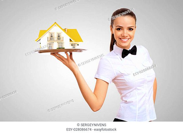 Waitress in white shirt with a tray and house on it