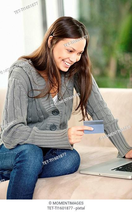 Brunette woman shopping online