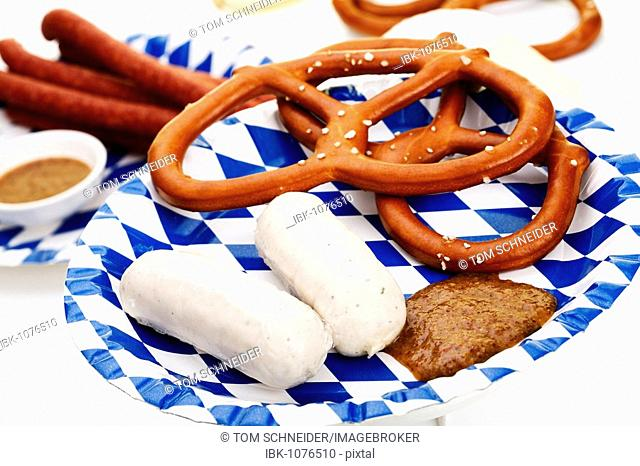 Veal sausages with sweet mustard, salted pretzels, ham Mettwurst sausages and beer