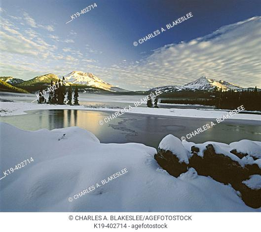 Sunrise on South Sister and Broken Top from Sparks Lake after fall snowstorm. Deschutes National Forest, Deschutes County. Oregon. USA