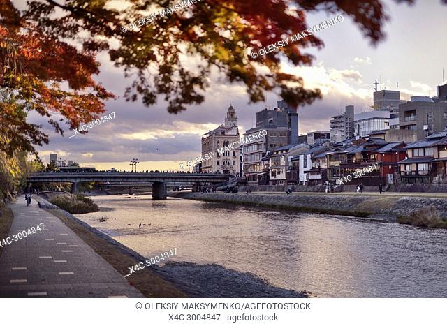 Shijo bridge over Kamo-gawa, Kamo River, in autumn sunset city scenery, Kyoto, Japan