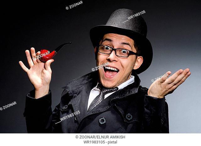 Funny detective with pipe and hat