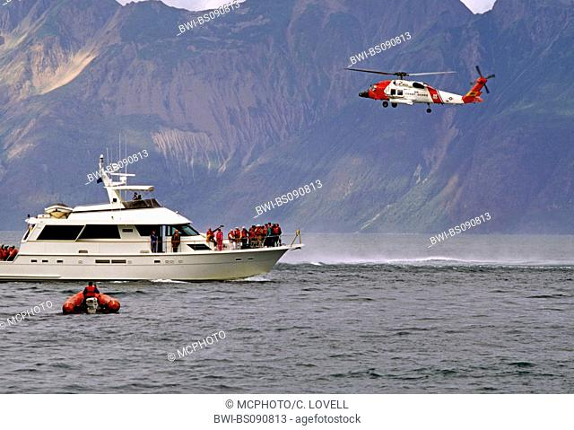 rescued passengers from the YORKTOWN CLIPPER aboard a private vessel with coast guard helicopter assisting, USA, Alaska, Glacier Bay National Park