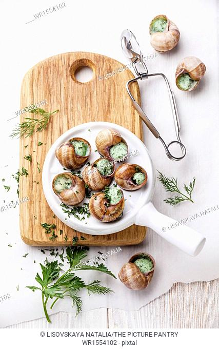 Preparation of snails with garlic butter sauce and fresh greens