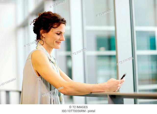 Woman looking at her cellular phone