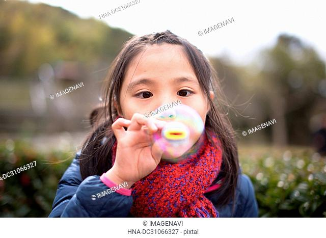 Playing soap bubble in the park